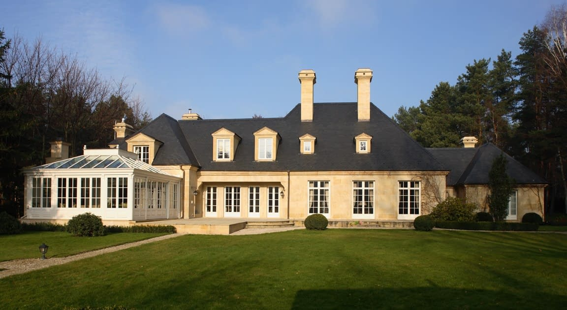 Traditional white wood windows and doors hand crafted by Architectural Openings