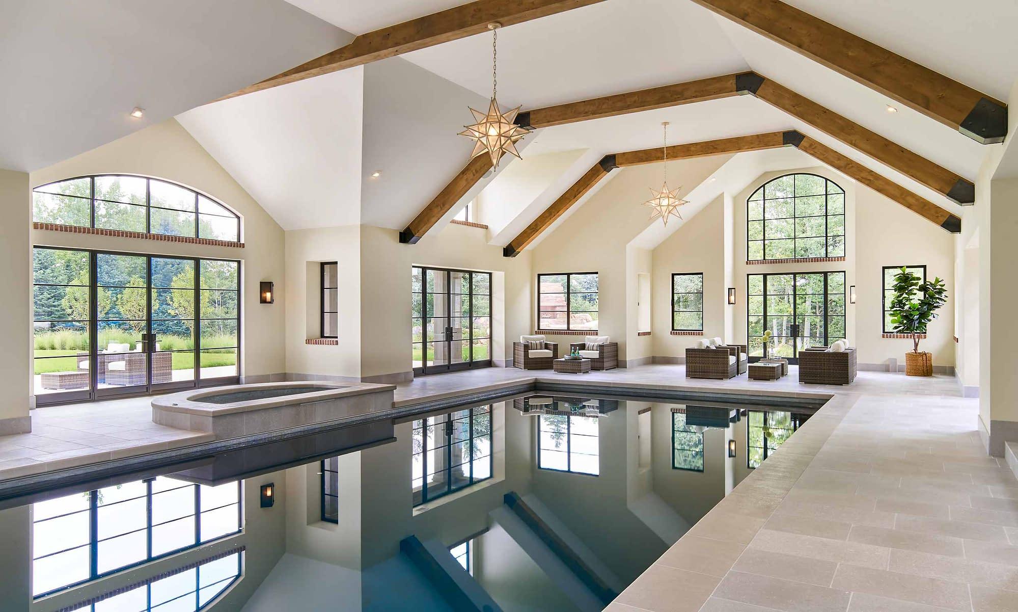 Brombal's custom luxury metal windows and doors are featured in this indoor pool