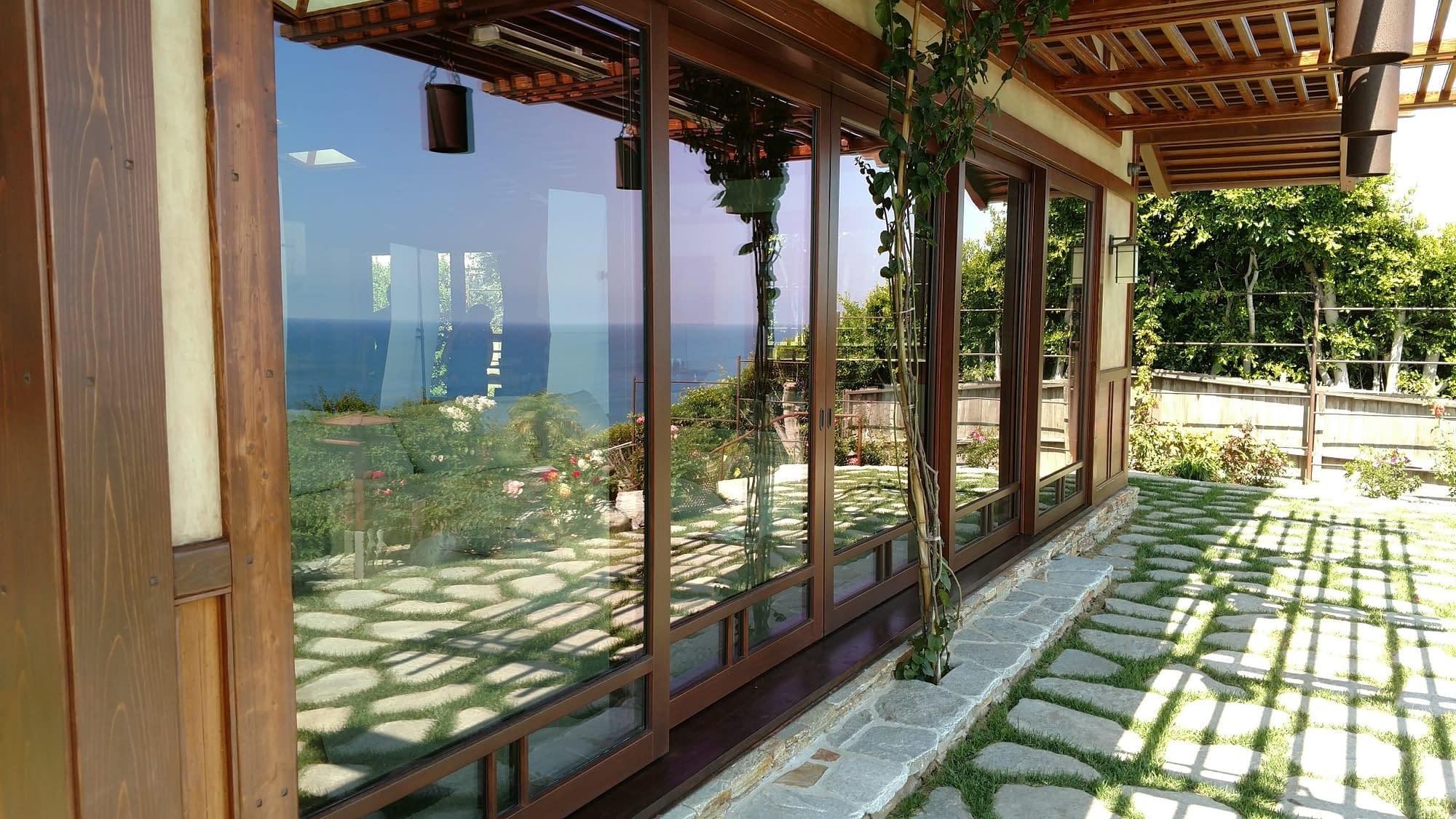 A custom wood lift slide door system by Veranda View